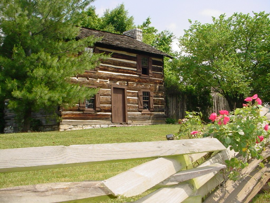 cabin with wooden fence